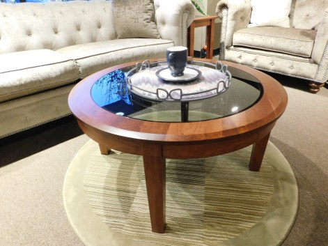 """Round Deluxe Shaker Coffee Table with Smoked Glass Top Wood Species Shown: Rustic Cherry Dimensions: 36""""Round x 18""""H Fully Customizable. Please contact us for pricing details."""
