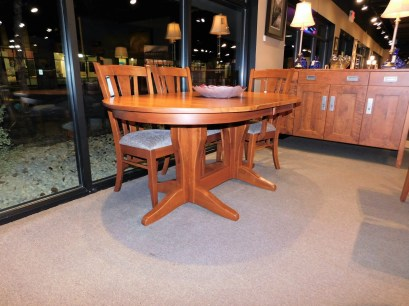 """Oval Vintage Double Pedestal Table with 2 12"""" Self-Storing Leaves and Eased Edge Wood Species Shown: Rustic Cherry Dimensions: 42""""W x 90""""L (open) Fully Customizable. Shown with Meridan Chairs. Please contact us for pricing details."""
