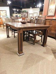 """Manhattan Table Manhattan Leg Table with 2 12"""" Self-Storing Leaves, Manhattan Top & Eased Mission Edge Wood Species Shown: Rustic Quartersawn White Oak Dimensions: 48""""W x 96""""L (open) Fully Customizable. Please contact us for pricing details."""