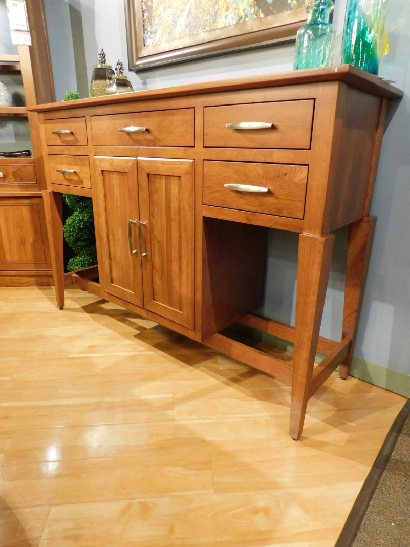"St. Croix Buffet with Wood Doors, Tapered Legs, Open Bottom Shelves and 1"" Smooth Top Wood Species Shown: Sap Cherry Dimensions: 64.5""W x 20.5""D x 44.5""H Price As Shown*: $2,475 Fully Customizable. *Price of piece not inclusive of current sales. Please see our Pricing page for more details."