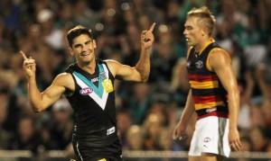 Teal or no teal, Port Adelaide's uniforms are wayyy better than rival Adelaide's tequila sunrise kit.