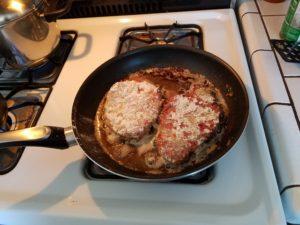 meat in pan 1st side