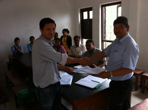 COMMITTED executive director and Dolagiri School Principal sign and exchange agreement on June 11, 2013.