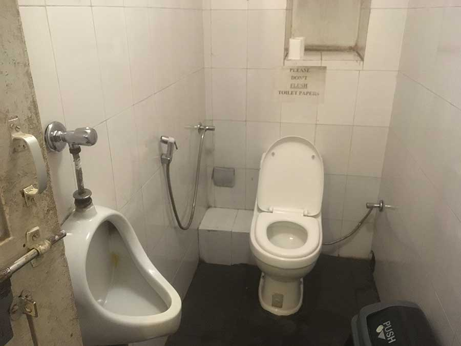 men's bathroom without the sexist promotional material