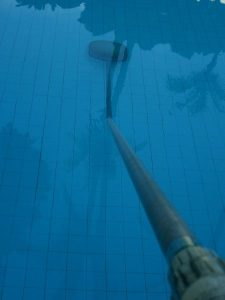 rod in pool at angle- back view