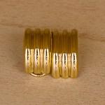 €299,00 – Orecchini a semicerchio con chiusura a clip in oro giallo 18k
