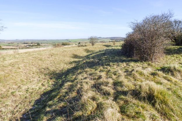 Grassy bank with views to countryside to left