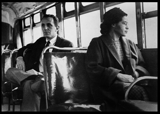 Photo of Rosa Parks seated on a bus