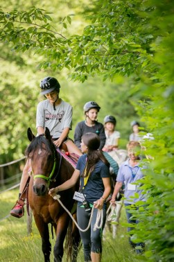 campers horseback riding