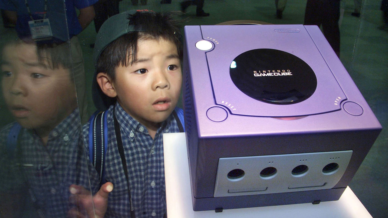 Japanese boy looking at GameCube