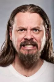 Caucasian Man With Long Hair Looking Angry