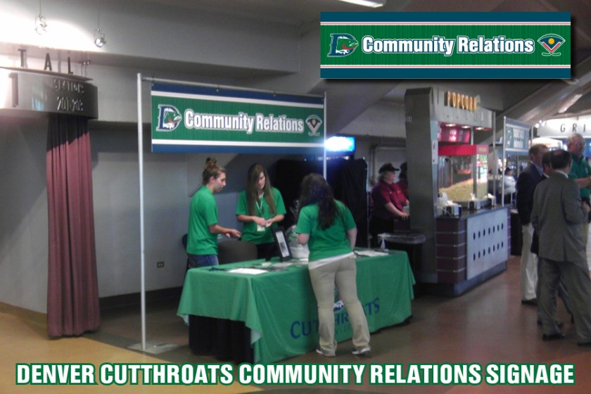 "Signage for the ""Community Relations"" booth inside the Denver Coliseum for the Denver Cutthroats home games."