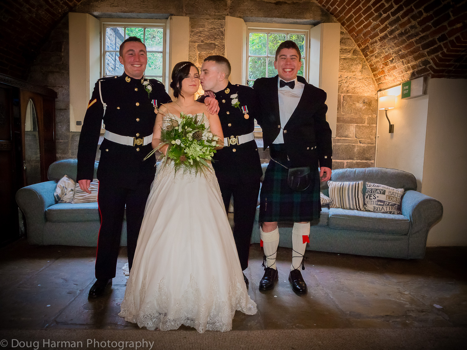 Emma and David interior group photo. A stunning location at Polhawn Fort for Dave and Emma's wedding.