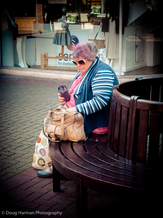 Putting her purse away after shopping at Wilko
