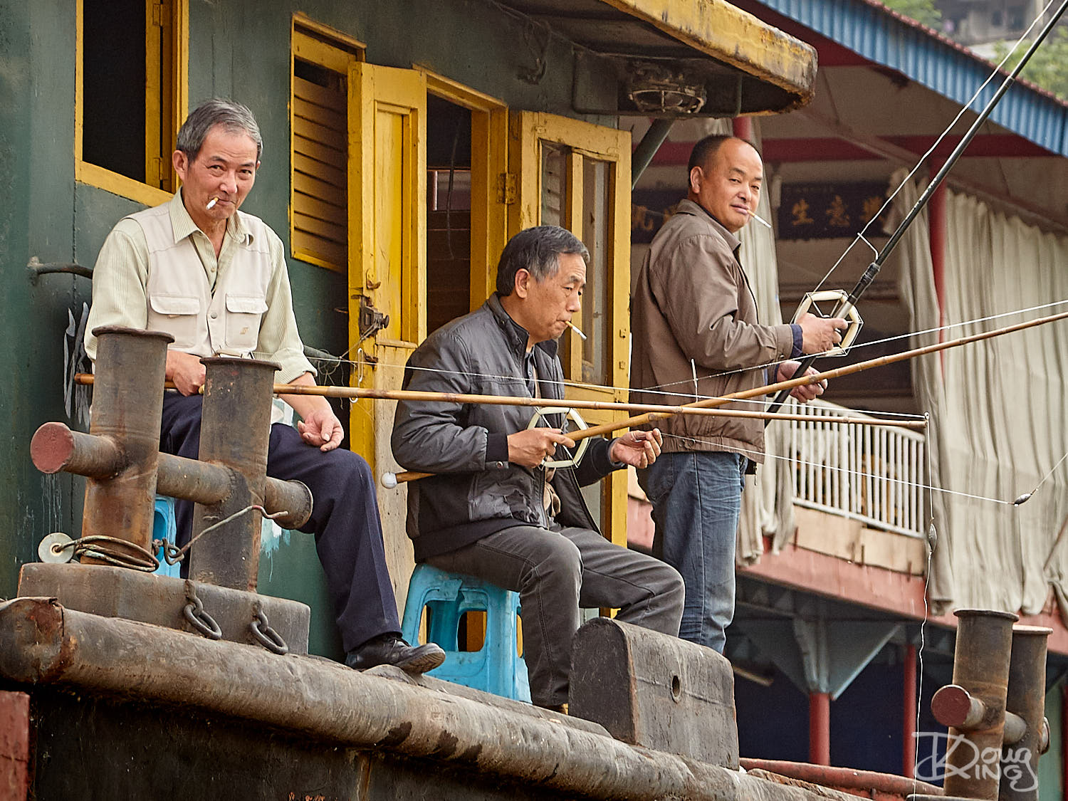 Three old men fishing off a barge in the Yangtze River
