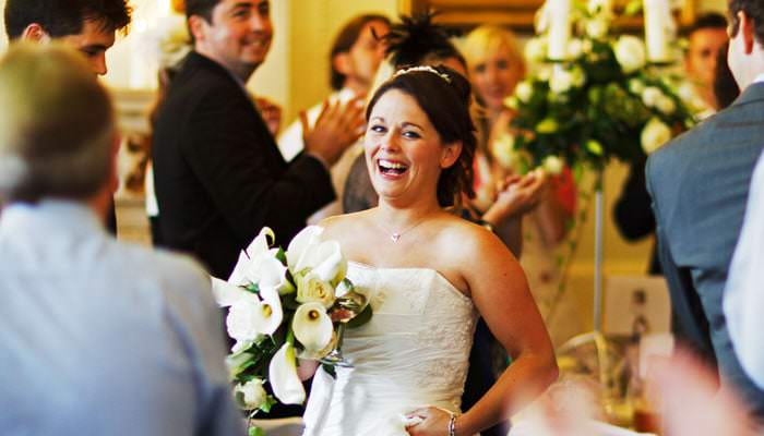 Wedding photograph of bride entering dinner at Northcote House, Ascot