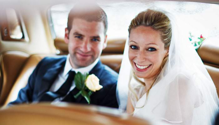 Wedding Photograph of Bride and Groom in Car, RIBA, London