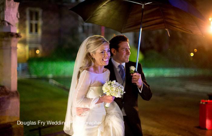 Wedding Photograph in Rain at Hampton Court Palace