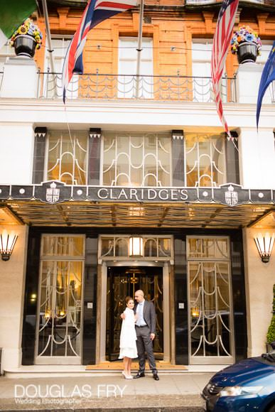 Front door of Claridge's Hotel with couple pictured