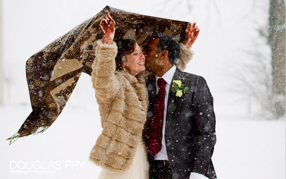 Couple photographed in Snow holding blanket