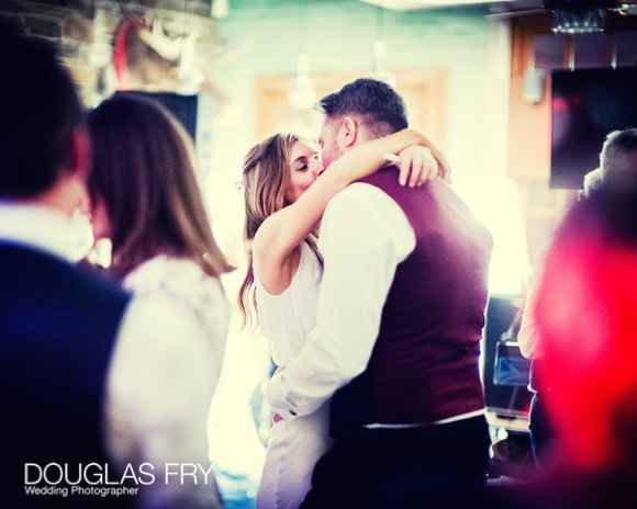 Bride and groom kissing during dancing phase of the day