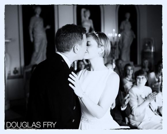 Black and white photograph of couple kissing after ceremony at Syon