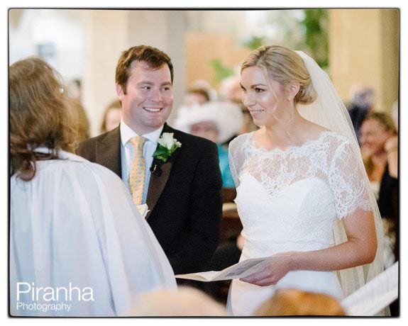Bride and groom in church pictured during ceremony at Crudwell Church