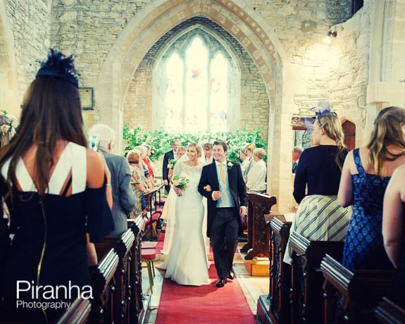 Wedding Photography of bride and groom walking down aisle in Gloucestershire