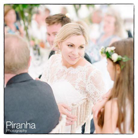 Bride during the reception talking to bridesamaid