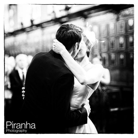 Black and white photograph of couple kissing during ceremony at Middle Temple