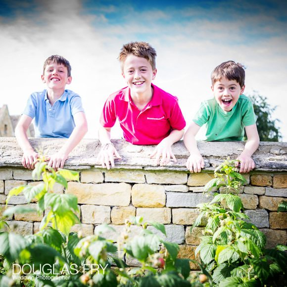 Boys playing on a wall in Gloucestershire