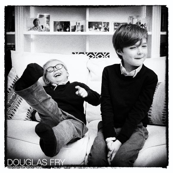 Two boys in black and white photographed at home