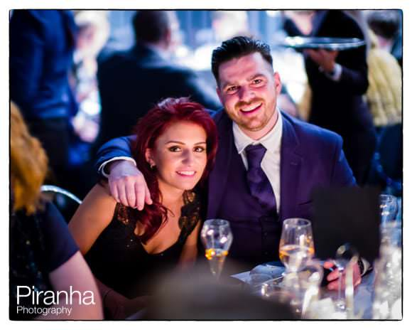 Guests photographed during wedding reception