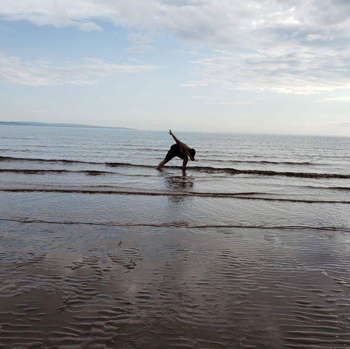 Dovico's Ryan Chitty having fun at the beach.