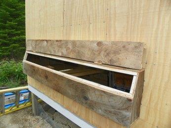 Coop nesting box opening