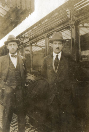 """Robert Dowling (left) and Fred McClenaghan (right), members of BCDR staff, about to board a """"family saloon"""" train at Newcastle following a staff day-out in the 1920s"""