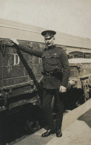 Royal Irish Constabulary officer Stuart Boyd beside a goods train in Belfast's Queen's Quay