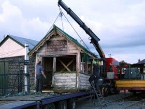 The former Bundoran Junction (North) signal cabin is offloaded late night at Downpatrick Station