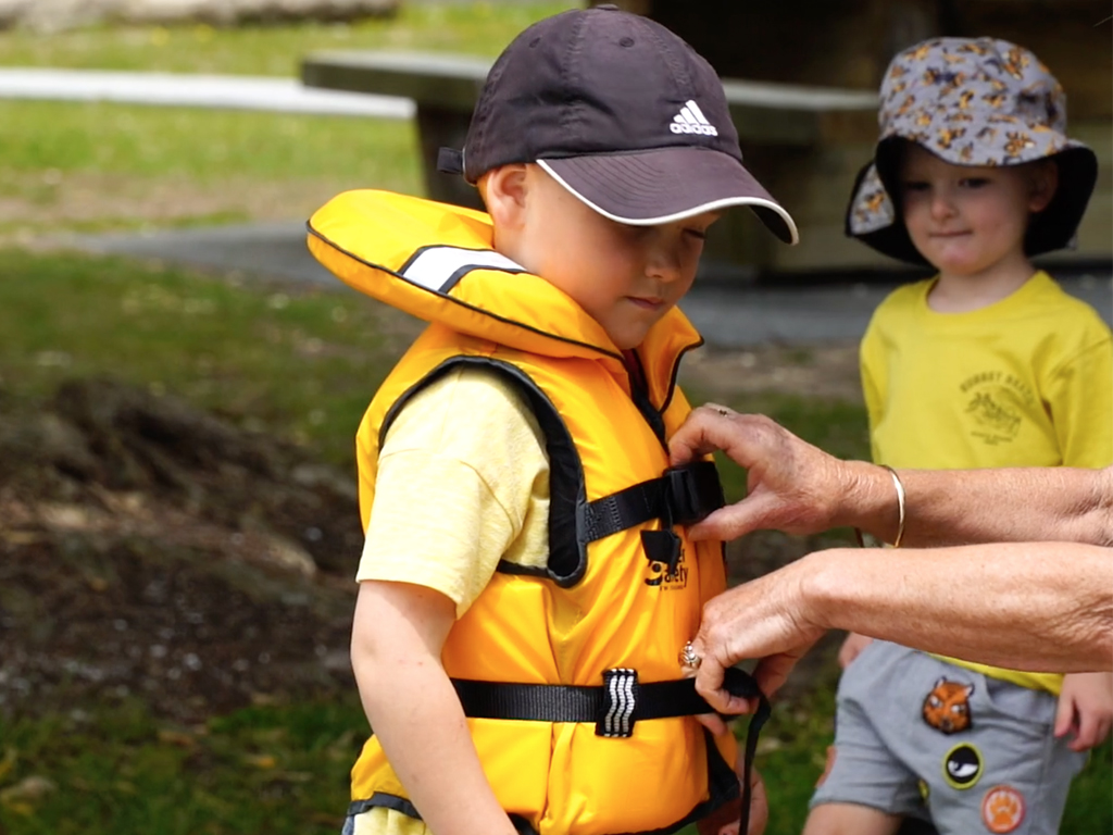 Checking the fit of a child's lifejacket