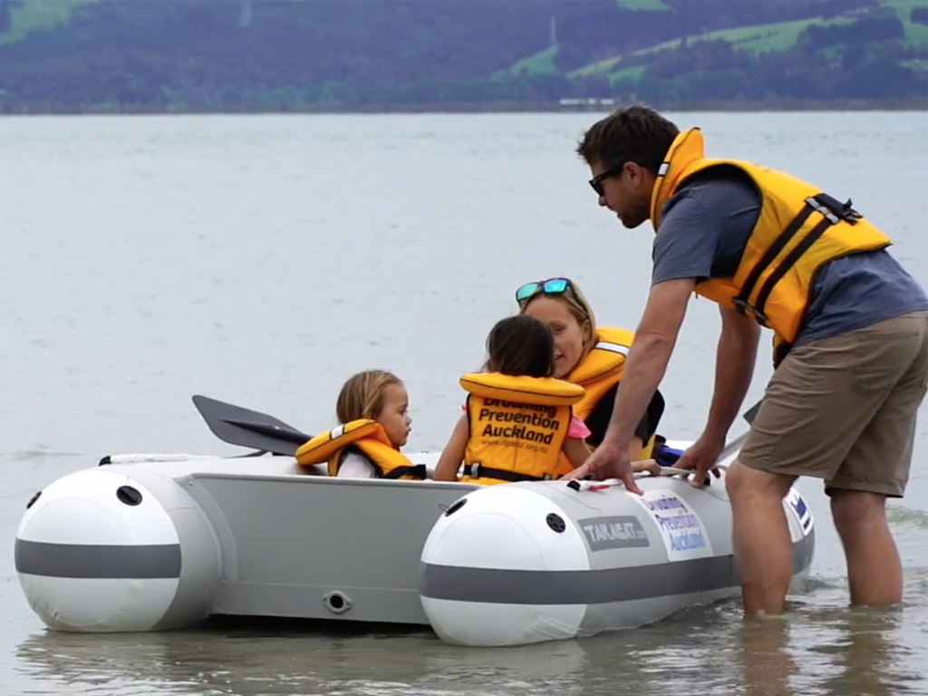 CHildren in boat with lifejackets