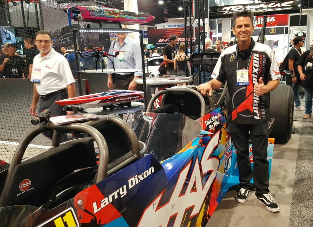Larry Dixon with 2 seat Top Fuel dragster Drag List