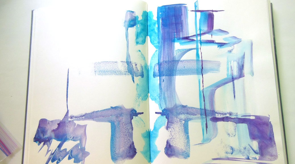 Purple and turquoise watercolor brushstrokes across facing journal pages.