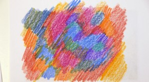 Scribble all over the back with crayons or colored pencils.