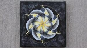Spiral grey and gold mandala design.