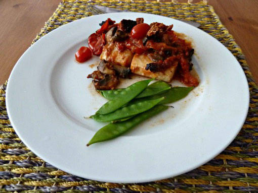Cod baked with chrizo and tomatoes