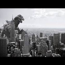 black and white image of godzilla over city
