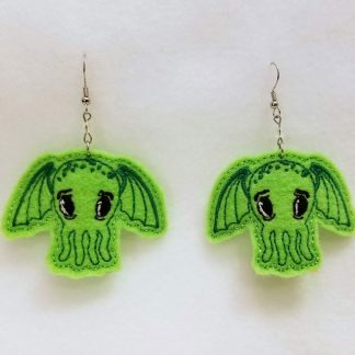 Chibi-Cthulhu Earrings on felt