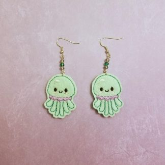 Kawaii Jellyfish earrings on felt