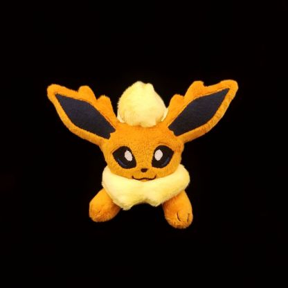 Flareon_inspired_laying_Front_view_1000
