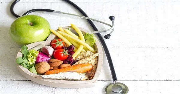blog picture of vegetables inside a heart with an apple and stethoscope lying next to the heart